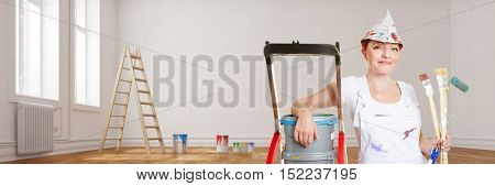 Woman as painter during renovation in house with paint and brushes
