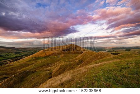 Colorful Sunset Clouds over Mam Tor Summit in Peak District National Park
