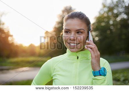 Happy Sporstwoman Talking On Mobile