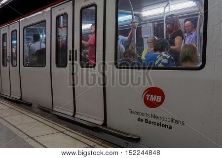 Barcelona, Spain - 24 September 2016: Barcelona metro coach stopped at platform. Metro wagon of TMB Transports Metropolitans de Barcelona with passengers inside.