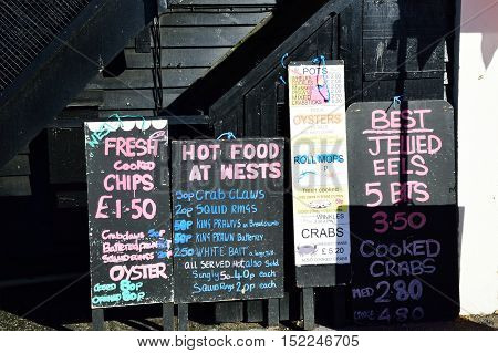 Whitstable United Kingdom -October 1 2016: Blackboard showing various Fish products for sale