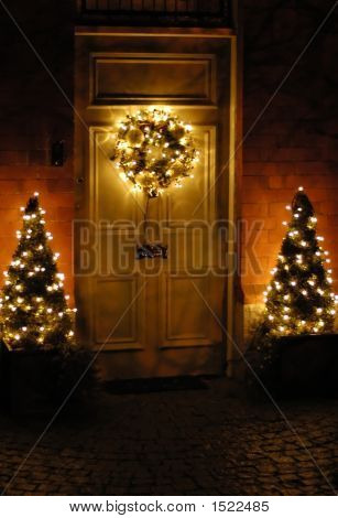 Beautiful Christmas Wreath Hanging On The Doors