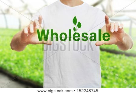 Wholesale concept. Young man push button on blurred background