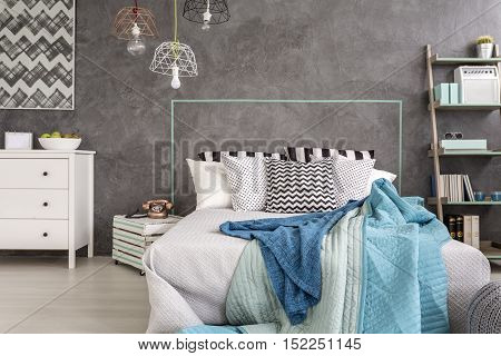 Double Bed With A Blue Bedcover