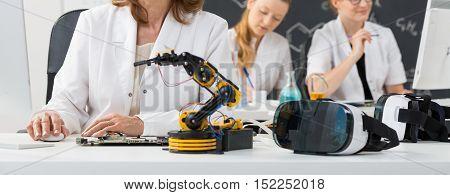 Three Scientists Working In Laboratory