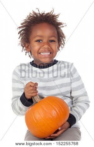 Funny African American boy with a pumpkin isolated on white background