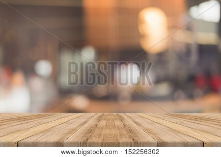 Wooden board empty table in front of blurred background. Perspective brown wood over blur in restaurant - can be used for display or montage your products.Mock up for display of product.