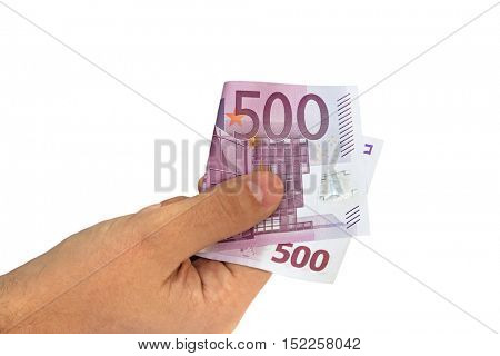 Manâ??s hand holding five hundred 500 Euro banknote money bill isolated on white background