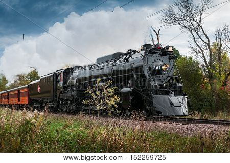 CHANHASSEN MN - OCTOBER 9, 2016: The Milwaukee Road #261 steam train on its annual Fall Colors Tour from Minneapolis MN to Glencoe MN. This line has not had regular passenger trains traffic since 1960.