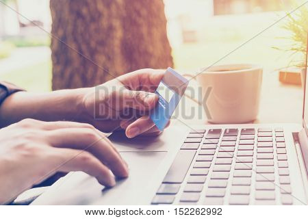 Close Up Hand Young Business Man Pay Credit Card In Coffee Shop With Vintage Filter