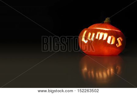 luminous pumpkin containing the graved word lumos