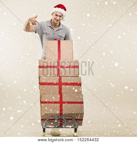 Courier a handcart gift boxes on beige