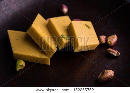 Indian Sweet Food Kaju Ketli and kesar barfi, diamond shape food item poster