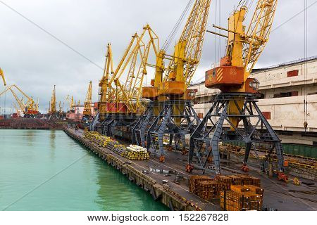 Odessa Ukraine - October 13, 2016: Container cranes in cargo port terminal cargo cranes without job in an empty harbor port. A crisis. Defaulted paralyzed entire economy