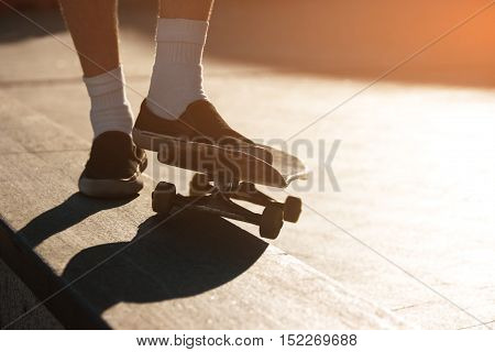 Skateboard and feet. Legs in slip-ons. Have no fear of failures. Skills come with time.