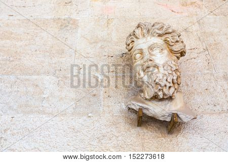 Head of Triton from Odeon of Agrippa, ancent statue fragment with copyspace