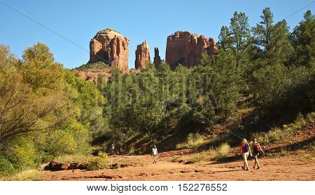 SEDONA, ARIZONA, OCTOBER 11. Red Rock Crossing on October 11, 2016, near Sedona, Arizona. A family hikes the trail toward famous Cathedral Rock at Red Rock Crossing near Sedona Arizona.