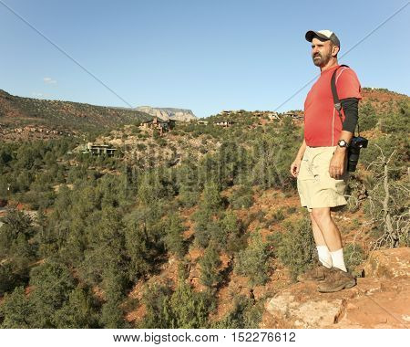 A Man Takes in the View from the Famous Cathedral Rock Trail Near Sedona Arizona