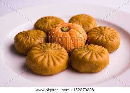 indian sweet pera or pedha,  indian sweet burfi in a plate, diwali sweet food poster