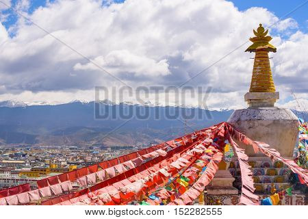Boudhanath Stupa with hundreds of Pigeons and Prayer flags in Shangrila China.