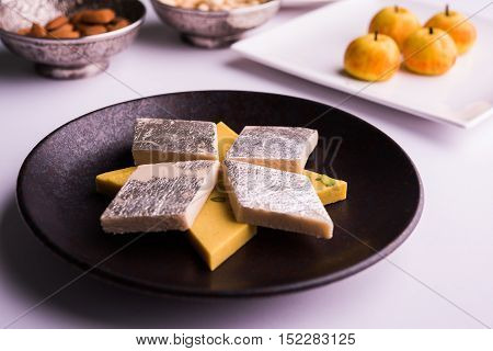 Indian Sweet Food Kaju Ketli and kesar barfi, diamond shape food item