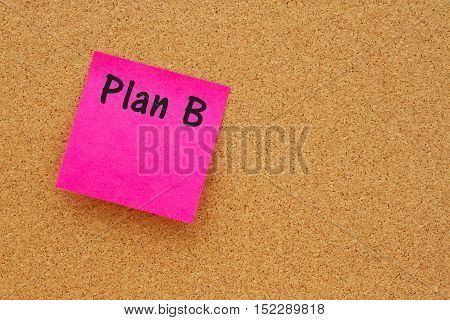 Reminder to have a Plan B message Bulletin board with a pink sticky note with text Plan B