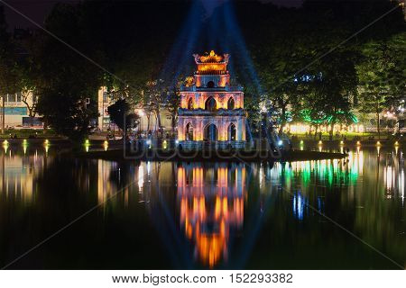 HANOI, VIETNAM - JANUARY 10, 2016: Turtle Tower on Hoan Kiem Lake in the spotlight. The historic center of Hanoi
