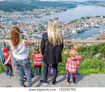 Teachers taking kids fron school to the city Bergen Norway