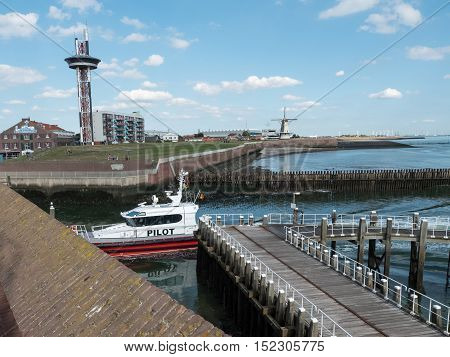 VLISSINGEN, NETHERLANDS - 12 SEPT. 2016: Pilot boat entering the harbor of Vlissingen in the province of Zeeland, Netherlands. Pilots boats assist large cargo ships on the North Sea to enter the port.