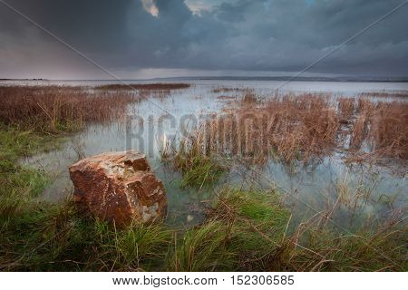 Storm clouds and a full tide at the Loughor estuary on the Gower peninsula in South Wales