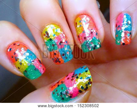 Flower art manicure. Valentines Day Holiday style bright Manicure with multi colors and polka dots. Bottle of Nail Polish. Beauty salon. Hand. Trendy Stylish Colorful Nails, Nailpolish