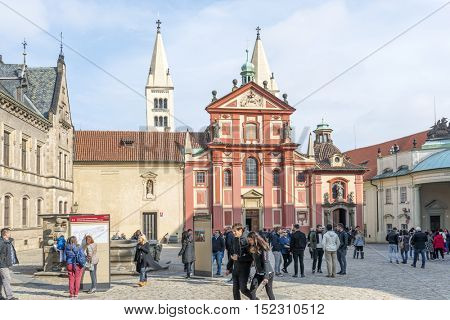 PRAGUE, OCTOBER 15: The crowd of tourists from around the world on the square in front of the St. George's Basilica in the Royal Palace on October 15, 2016 in Prague, Czech Republic.