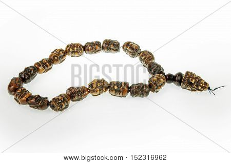 Mongolian rosary isolated over white background heads