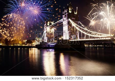 new zear in the city - Tower bridge with firework, celebration of the New Year in London, UK