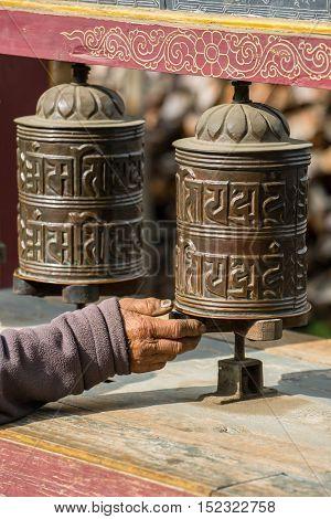 Manang, Nepal - May 5, 2016: Buddhist prayer mani wall with prayer wheels in nepalese village on the Annapurna circuit trekking route, Nepal