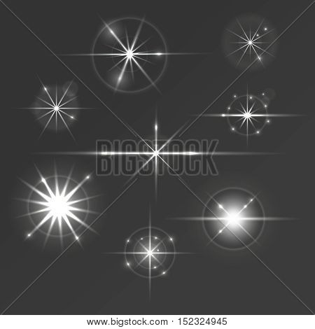 Set of glowing light stars with sparkles and circles. Glare, flickering and flashing effects.
