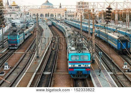 old trains on ukrainian railways. Railway station on background.People are waiting on platform - Odessa railway station