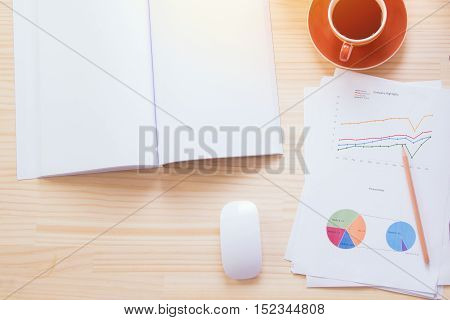 Top view of workplace economist at office table