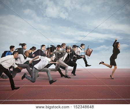 Businesswoman exults winning during a race with opponents