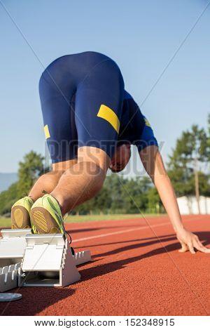 Athletic Man Starting Jogging In Sun Rays
