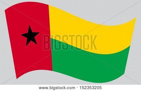 Bissau-Guinean national official flag. Patriotic symbol banner element background. Correct colors. Flag of Guinea-Bissau waving on gray background vector