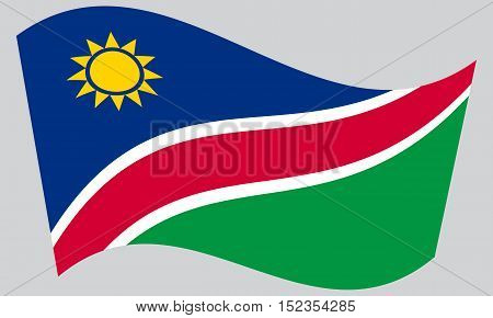 Namibian national official flag. African patriotic symbol banner element background. Correct colors. Flag of Namibia waving on gray background vector