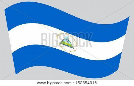 Nicaraguan national official flag. Patriotic symbol banner element background. Correct colors. Flag of Nicaragua waving on gray background vector
