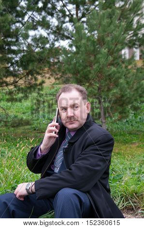 A Man talking on the phone outdoors
