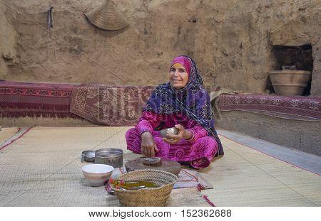Nizwa Oman October 13th 2016: omani lady preparing sandlewood paste