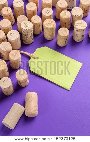 Wine cork stoppers with green label on purple background.Useful as alcohol background.