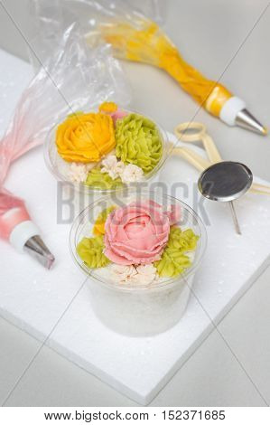 Tteok korean rice flour steamed cake with colored bean paste decoration vertical
