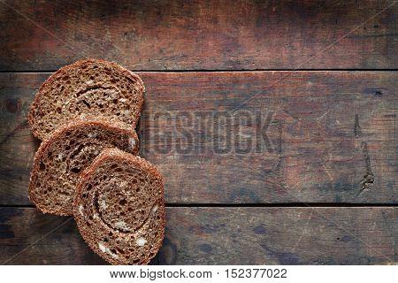 Freshness sliced rye bread on old wooden background