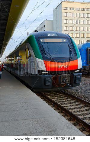 MINSK BELARUS - OCTOBER 1 2016: Unidentified people are waiting to board in electric train of business class EPM-001 of company Stadler (line Minsk-Gomel) on platform of railway station Minsk