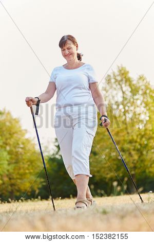 Happy senior woman hiking for rehab training for her health